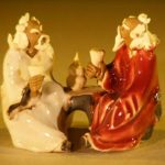 Miniature Ceramic Figurine Two Men Sitting at a Table with Fine Detail Color:White & Red