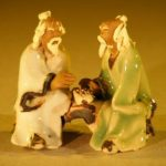 Miniature Ceramic Figurine Two Men Sitting at a Table with Fine Detail Color: White & Green