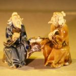 Miniature Ceramic Figurine Two Men Sitting at a Table with Fine Detail Color: Blue & Brown