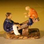 Ceramic Figurine Two Boys on a See-Saw
