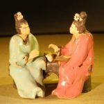Miniature Ceramic Figurine Two Women Sitting at a Table Color: Red & Green