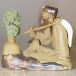 Ceramic Figurine: Man with Bonsai Tree Holding a Brush