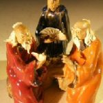 Miniature Glazed Figurine Three Men Sitting on a Bench with fine detail