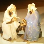 Miniature Glazed Figurine Two Men Sitting on a Bench Reading Books Color: White & Light Blue